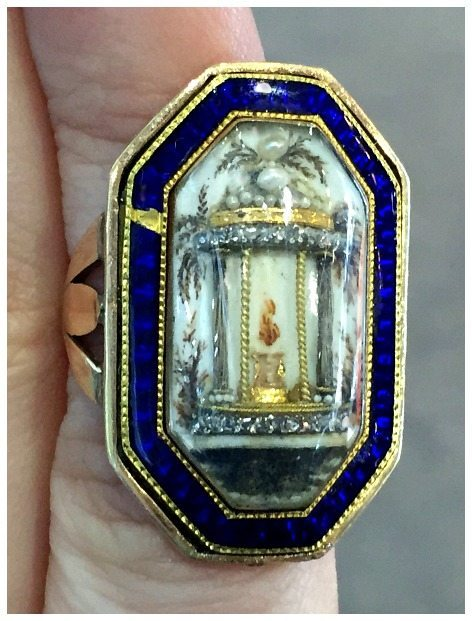 A remarkable antique Georgian ring with a three dimensional motif of a classical temple and a flame. At Micheal Longmore.