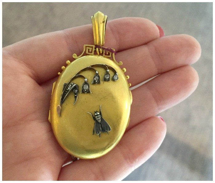 A wonderful gold locket from the Victorian era, with a floral and fly design.