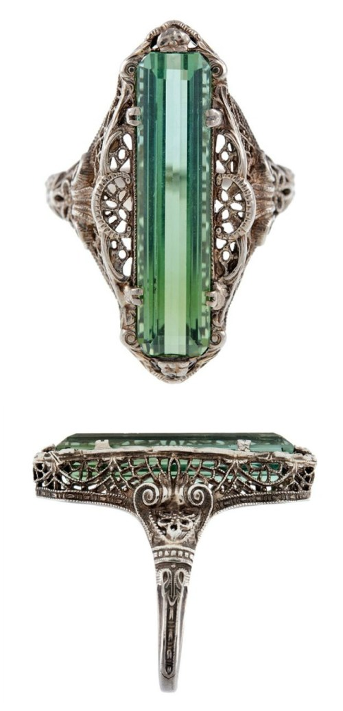 An antique green tourmaline filigree ring from the Victorian era, circa 1880.