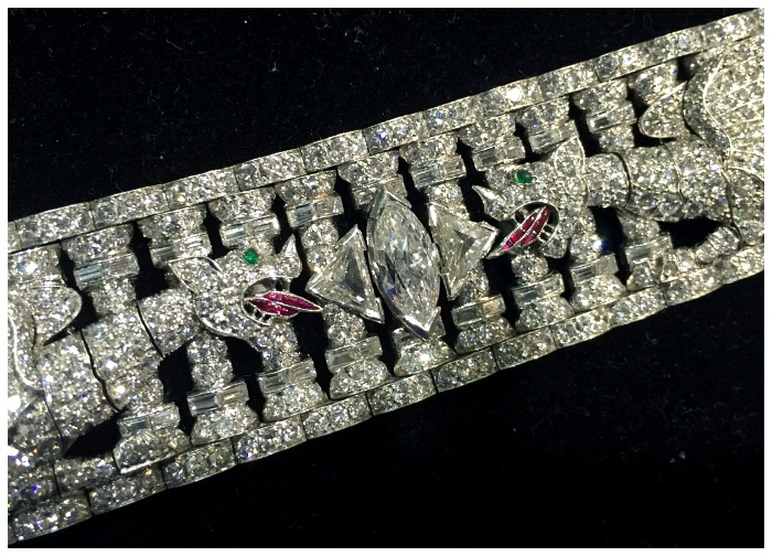 An incredible Art Deco diamond bracelet featuring two dragons with ruby tongues and emerald earrings. From Pat Saling.