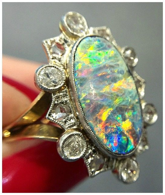An incredible antique opal and diamond ring from Prather Beeland. This beauty was originally a brooch.