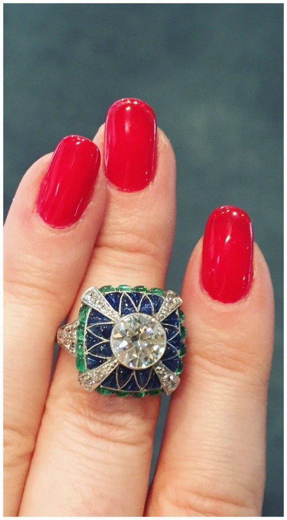 Art Deco ring with sapphires and emeralds around a central diamond. Fantastic. From Mario's Antiques.