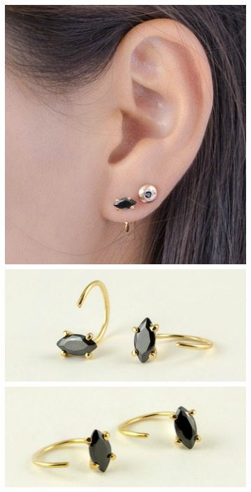 Black zircon hug hoop earrings in yellow gold-plate. Also available in rose or white gold-plated.