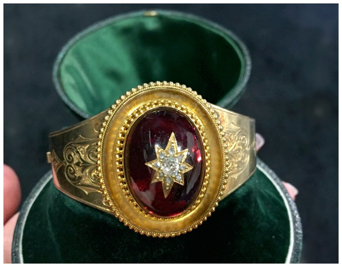 A beautiful Victorian gold cuff bracelet with a huge cabochon garnet inset with a diamond star. At Cynthia Findlay.