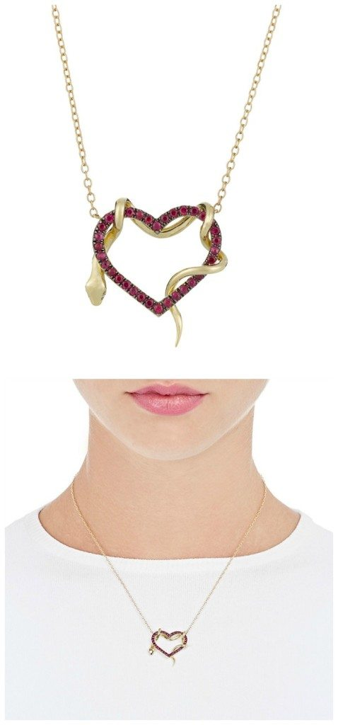 A heart and snake pendant necklace by Finn. In gold, with rubies on the heart and diamond eyes on the snake.