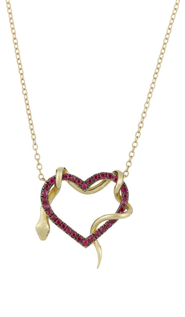 A heart and snake pendant necklace by Finn. In gold, with rubies on the heart and perfect diamond eyes on the snake. Front and back views.