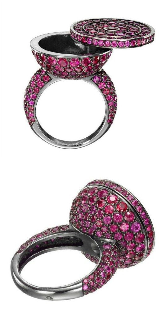 A hidden compartment poison ring from Boucheron. With 270 circular-cut rubies (6.93 total carats) in blackened gold.
