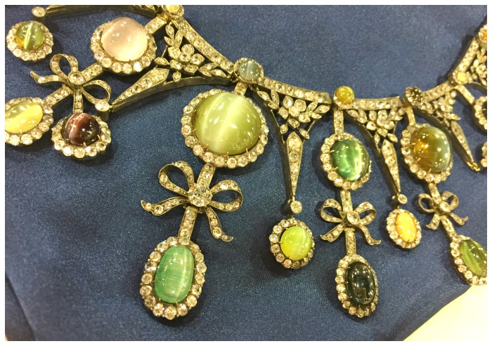 Close up view of a rare and magnificent antique cat's eye and diamond necklace. Featuring sapphires, chrysoberyl, emeralds, and alexandrite. At Jogani.