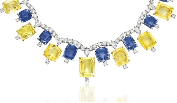 Detail; a retro blue and yellow sapphire necklace by Cartier, with diamonds. Circa 1957.