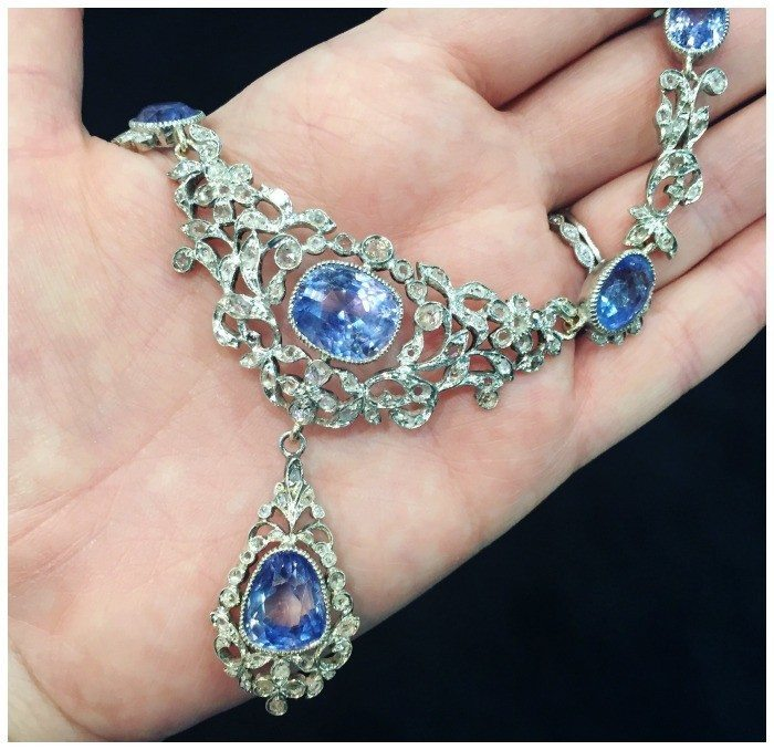 Detail of an incredible turn of the century necklace with rose cut diamonds and 80 carats of blue sapphires. From Terry Lucy jewelry.