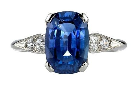 A exceptionally elegant 3.77ct cushion cut sapphire ring with diamond accents.