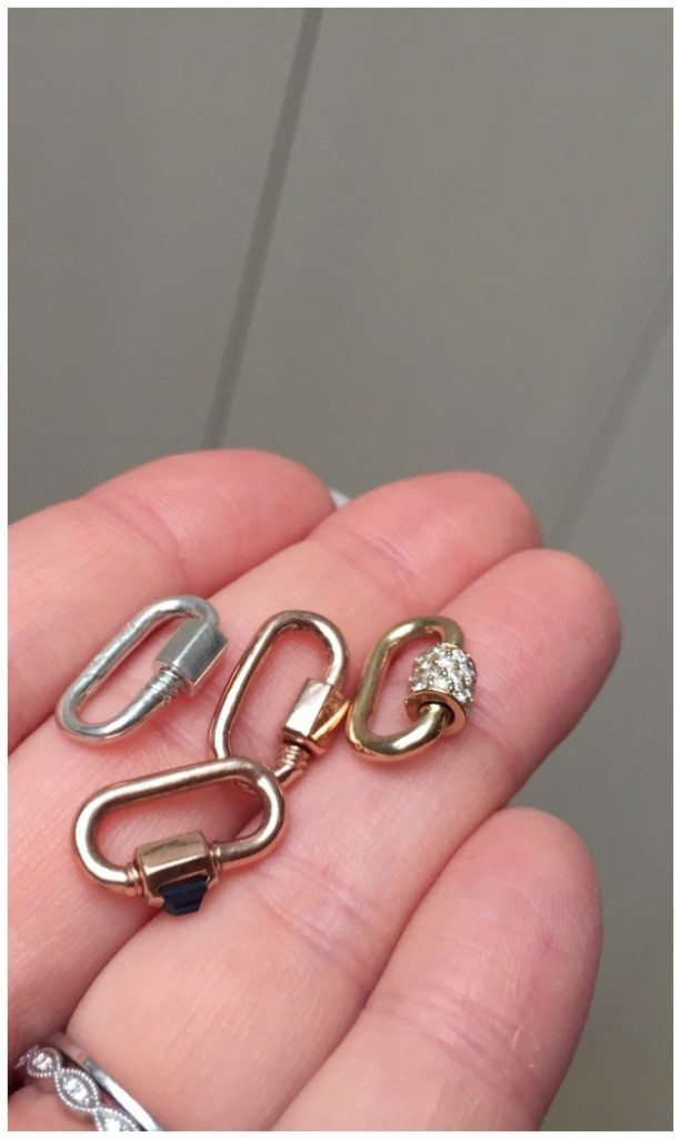 A handfull of Marla Aaron baby locks - the smallest size these beauties come in.