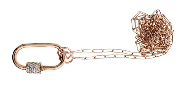 A yellow gold Marla Aaron lock with diamonds on a yellow gold chain.