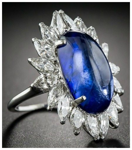 An incredible sapphire ring. The center cabochon is nearly 13 carats, with 3.50 carats of diamonds surrounding it.