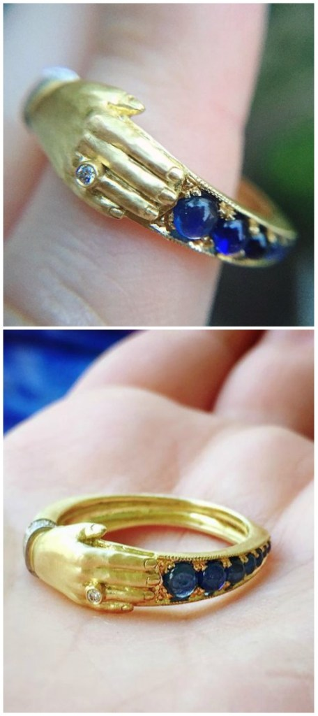 The Anthony Lent one hand band in gold with cabochon sapphires and diamonds.