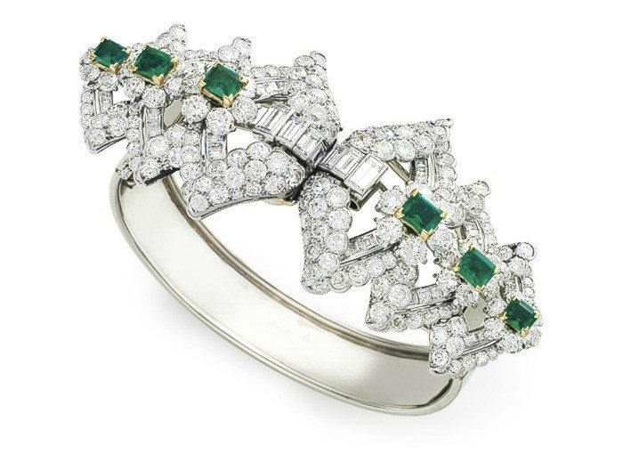 This glorious Art Deco emerald and diamond bracelet is by Cartier, Paris. The top is two gem-encrusted dress clips, both of which detach. Circa 1925.