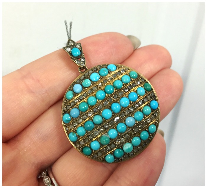 A beautiful antique Victorian turquoise and diamond locket in gold. At A Brandt and Son.