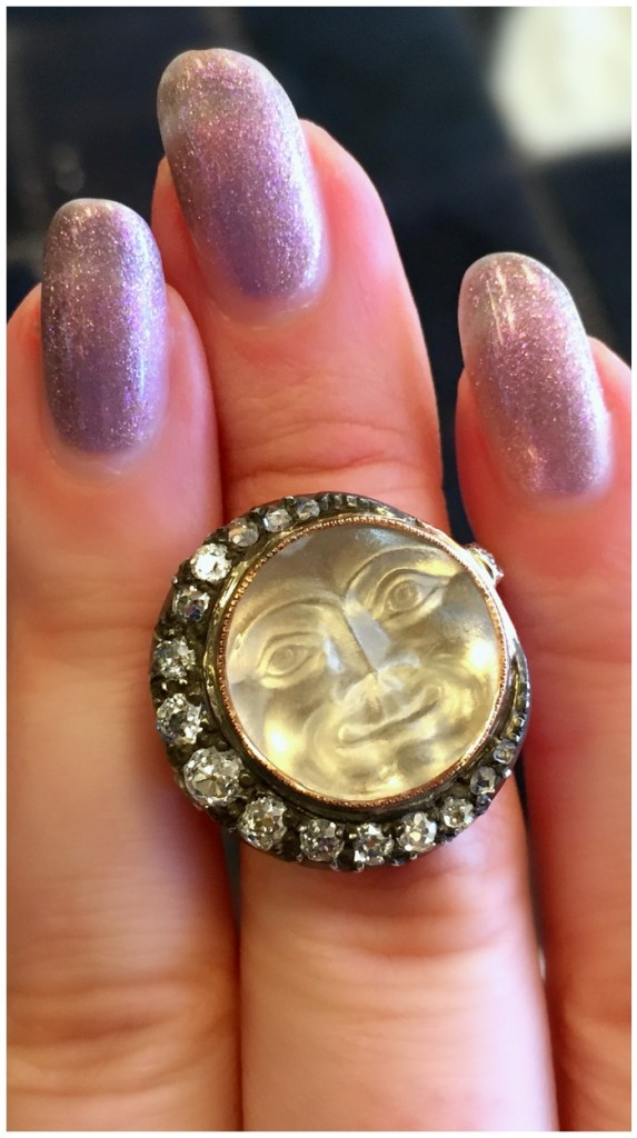 An incredible antique man in the moon ring from A Brandt and Son. Carved rock crystal with diamonds.