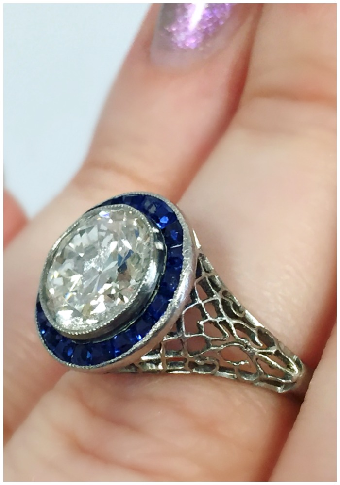 Stunning deatils on an Art Deco sapphire and diamond engagement ring with filigree details. At A Brandt and Son.