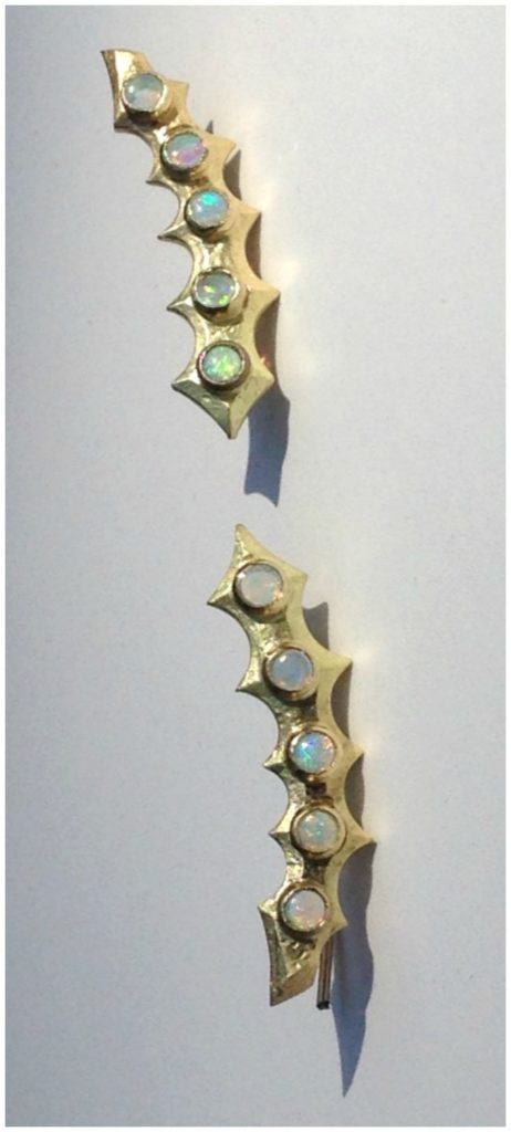 The Opal Spine ear climbers in 18k gold. From Lisa Kim's newest jewelry collection, The Seabeast.