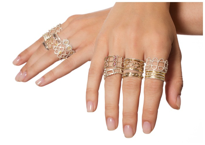 Two hands' worth of mixed metal stacking rings from Sophie Ratner jewelry.