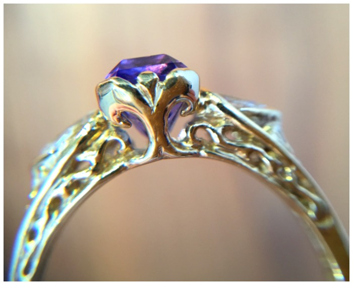 Side view of an incredible tanzanite ring in gold. Handmade by Hunt Country Jewelers.