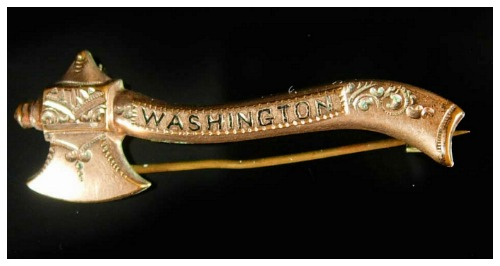 This antique Victorian era gold filled brooch shaped like an axe is in memory of George Washington. It's a reference to the infamous 'I cannot tell a lie' cherry tree story.
