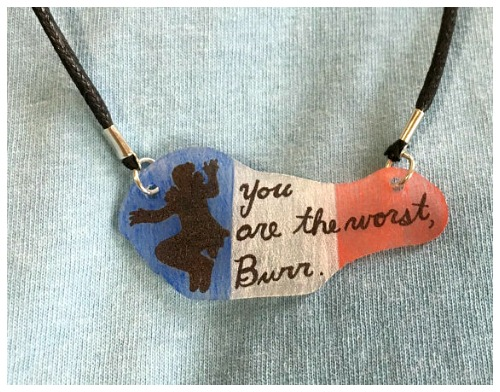 This necklace bears Lafayette's infamous line from the musical Hamilton - 'You're the worst, Burr.'