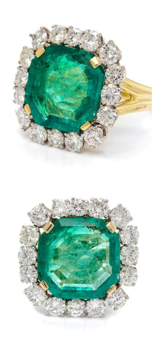 A Platinum, Colombian Emerald and Diamond Ring, containing one octagonal step cut emerald and 16 round brilliant cut diamonds weighing approximately 2.97 carats total.