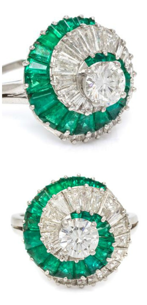 A Platinum, Diamond and Emerald Ring by Oscar Heyman Brothers.
