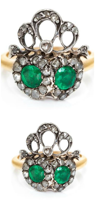 A Victorian era silver, gold, emerald and diamond double heart ring, circa 1880.