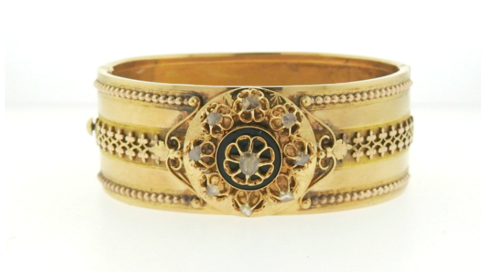 A Victorian gold and diamond bangle bracelet.