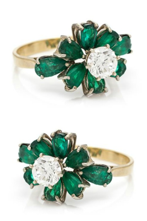 A Yellow Gold, Diamond and Emerald Ring, containing one round brilliant cut diamond weighing approximately 0.73 carat and eight pear shape emeralds weighing approximately 2.08 carats total.