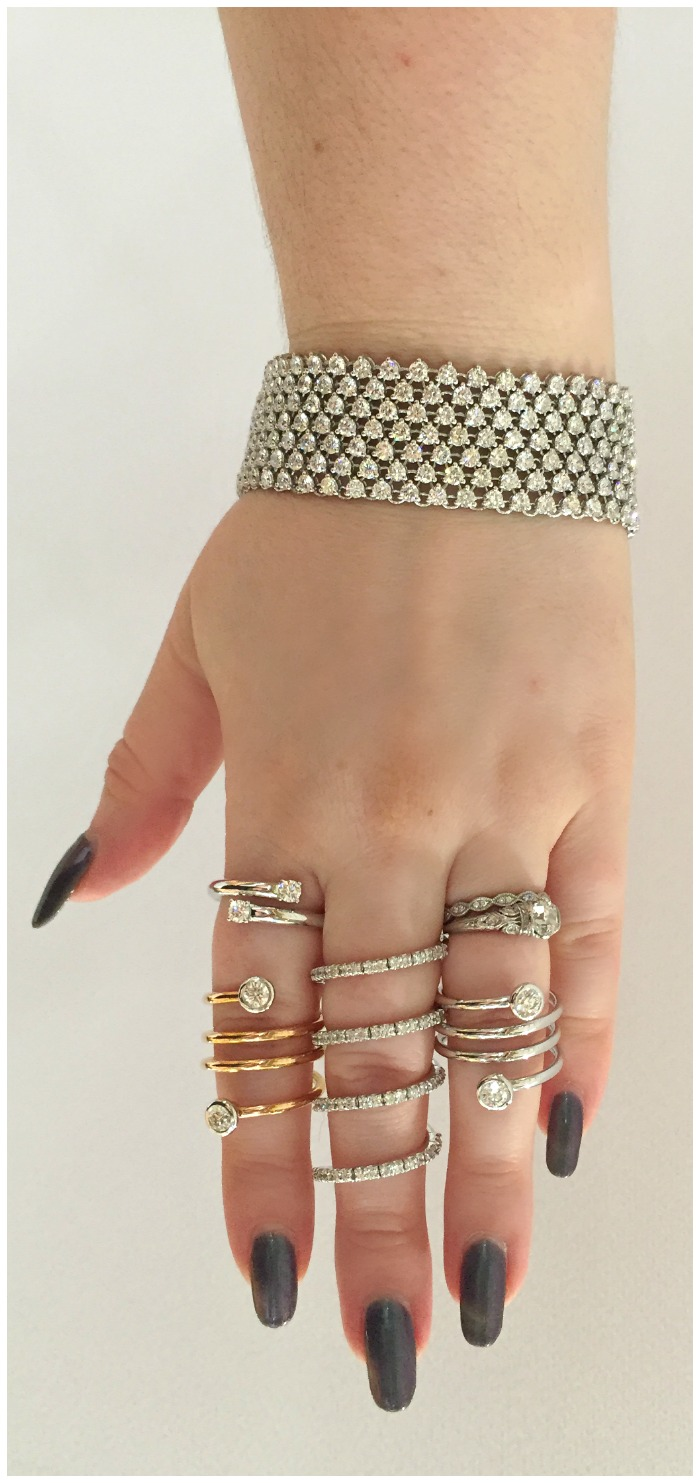 A diamond bracelet and several diamond rings by A Link on blogger Becky of Diamonds in the Library at JCK Luxury Prive.