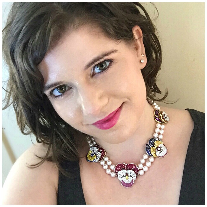 Becky of Diamonds in the Library modeling a swoonworthy Oscar Heyman necklace, which features several of the brand's iconic pansy pieces strung on a double pearl necklace.