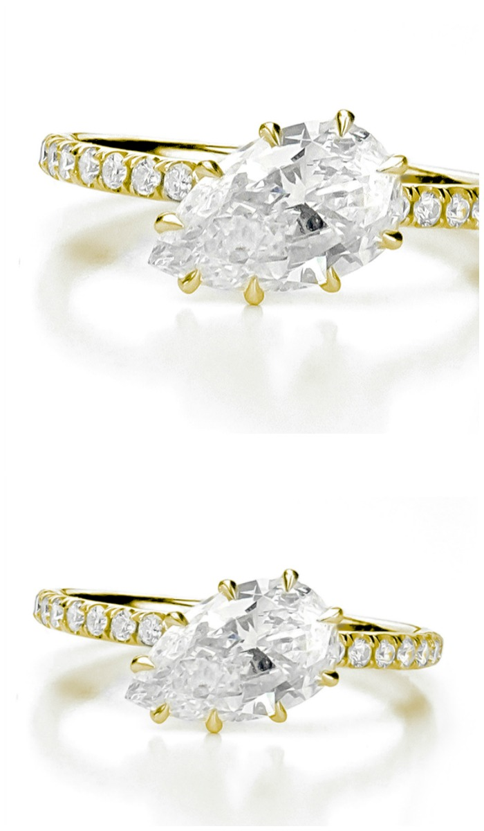 Forevermark by Jade Trau Free Bird diamond solitaire engagement ring set in 18k yellow gold