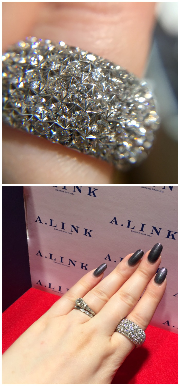 Playing with a gloriously large A. Link diamond ring on A Link's finger-sized red carpet at JCK Luxury Prive.