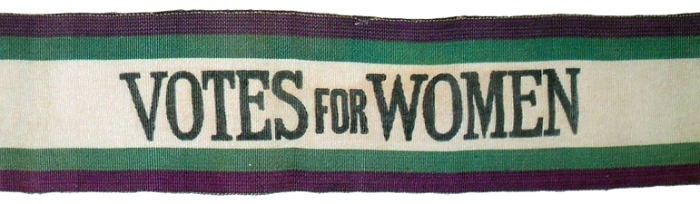 A purple, green, and white suffragette sash.