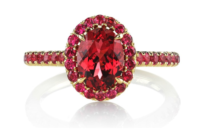 The Omi Prive Dore' ring featuring a 1.48 carat oval red spinel surrounded by 0.56 carats of round red spinels in 18k yellow gold.