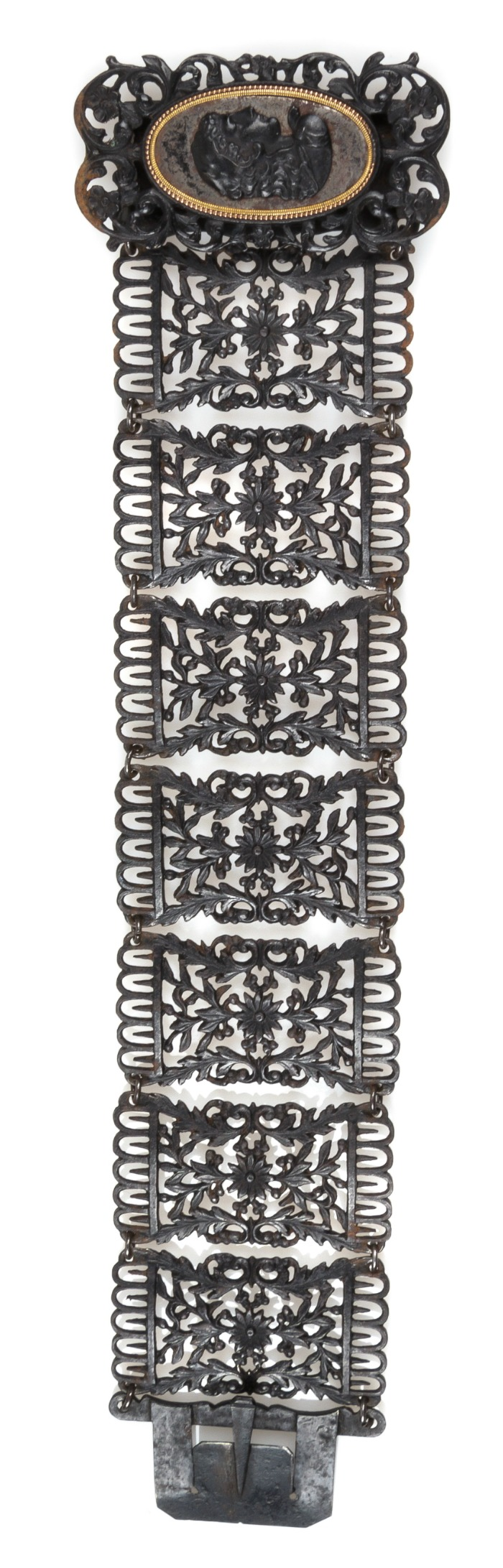 A stunning antique Berlin Ironworks bracelet with a cameo clasp and floral details.