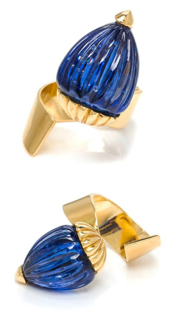 An unusual 18k gold and sapphire wrap wring by J. Vendome, Paris.