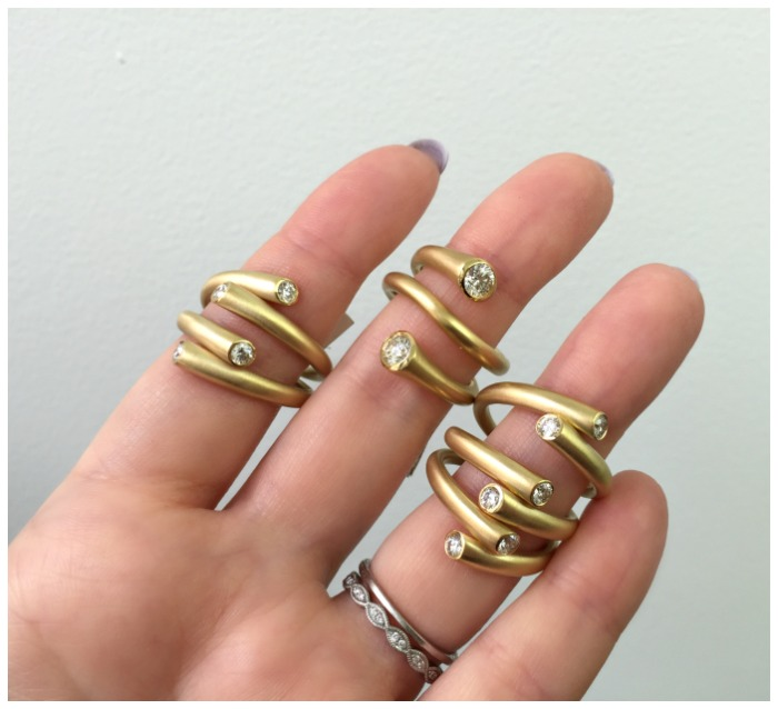 Fabulous gold and diamond whirl rings by Carelle.