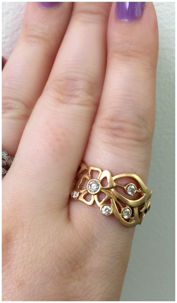 A beautiful rose gold and diamond floral ring by Carelle.
