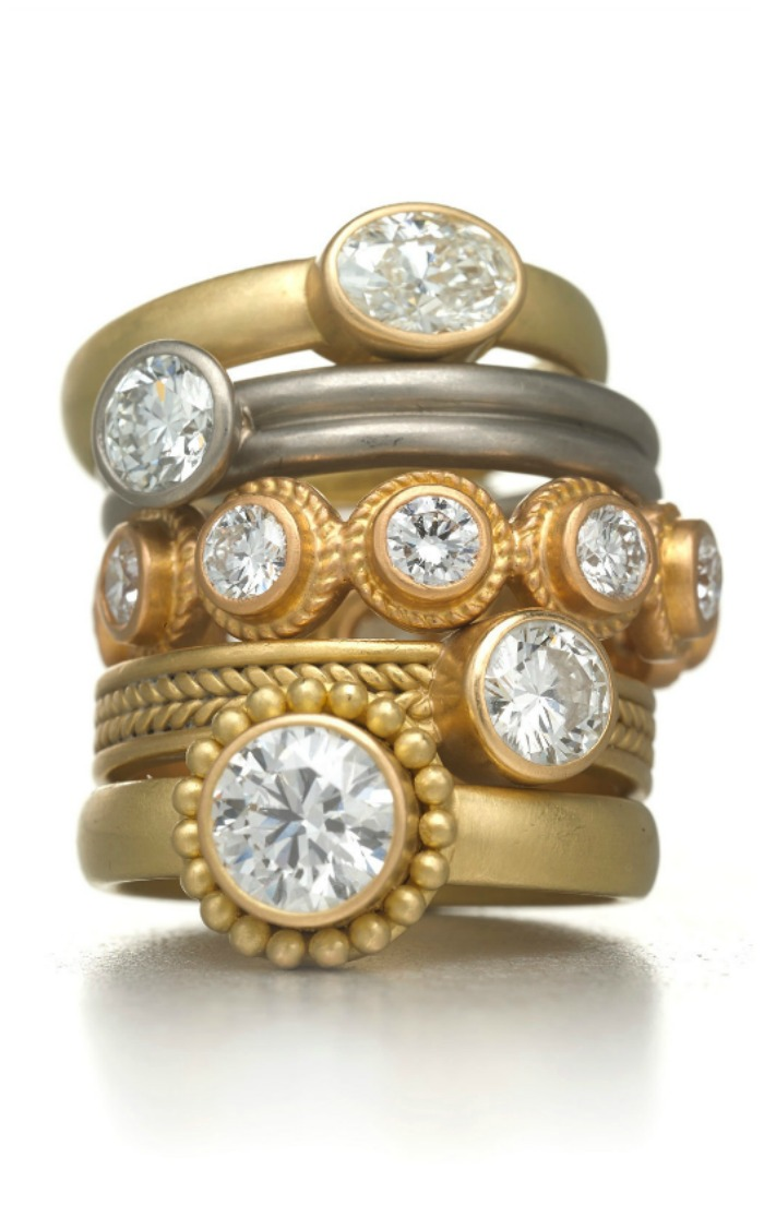 A stack of Reinstein Ross gold and diamond rings.