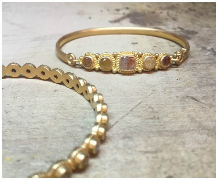 Gold and diamond bracelets by Reinstein Ross.