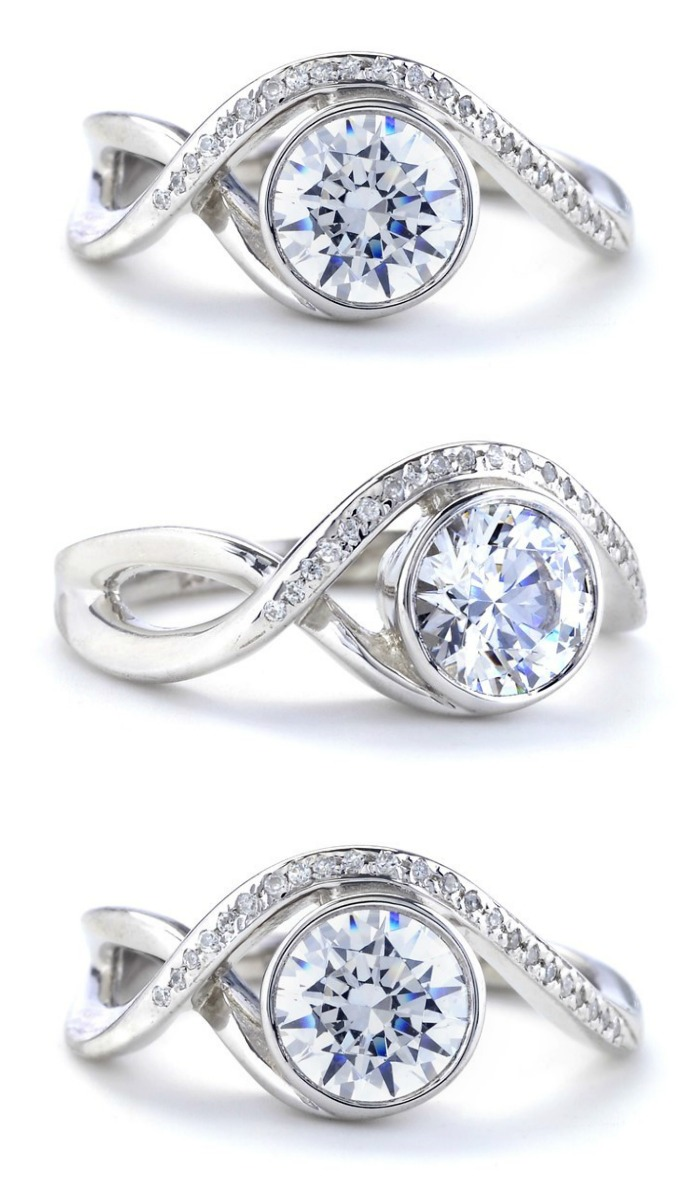 Mark Schneider Aurora engagement ring setting in white gold with a round brilliant cut diamond.