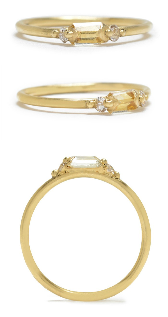 Polly Wales caged baguette diamond ring with a yellow baguette diamond between two white diamonds.