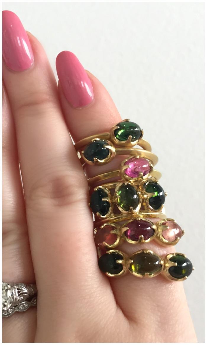 A stack of beautiful tourmaline cabochon rings by Mimi Favre Studio.