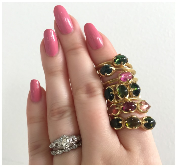 A stack of beautiful tourmaline cabochon rings by Mimi Favre Studio.