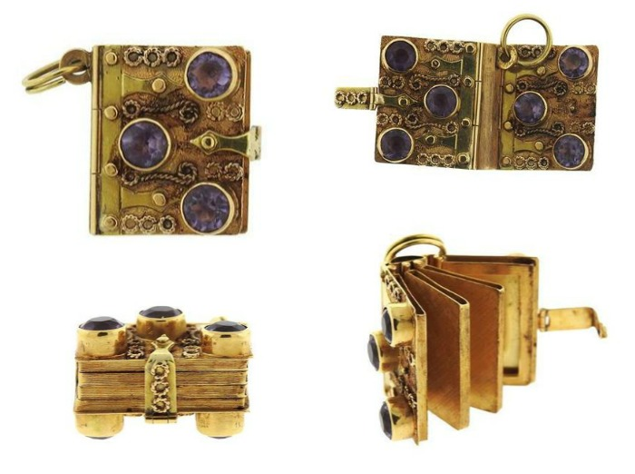 An incredible antique book locket in 18K yellow gold with amethyst stones.